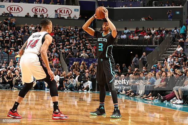 Jeremy Lamb of the Charlotte Hornets defends the ball against the Miami Heat during Game Three of the Eastern Conference Quarterfinals during the...