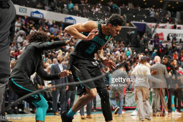 Jeremy Lamb of the Charlotte Hornets drenched in water by teammates after making game winning basket against the Toronto Raptors on April 5 2019 at...