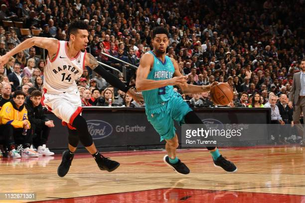 Jeremy Lamb of the Charlotte Hornets drives through the paint during the game against Danny Green of the Toronto Raptors on March 24 2019 at the...