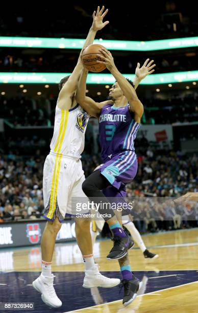 Jeremy Lamb of the Charlotte Hornets drives to the basket against Klay Thompson of the Golden State Warriors during their game at Spectrum Center on...