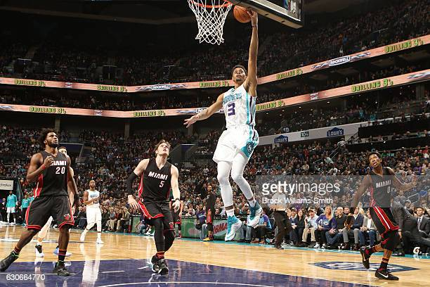 Jeremy Lamb of the Charlotte Hornets dunks against the Miami Heat during the game on December 29 2016 at Spectrum Center in Charlotte North Carolina...