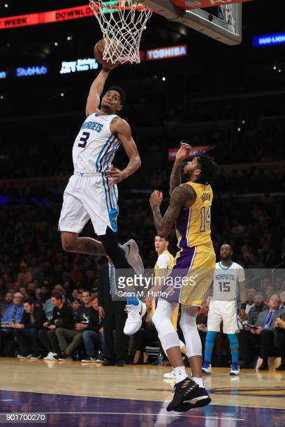 Jeremy Lamb of the Charlotte Hornets dunks over Brandon Ingram of the Los Angeles Lakers during the first half of a game at Staples Center on January...