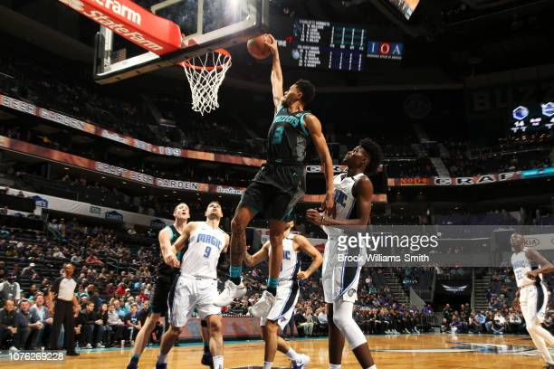 Jeremy Lamb of the Charlotte Hornets dunks the ball against the Orlando Magic on December 31 2018 at Spectrum Center in Charlotte North Carolina NOTE...