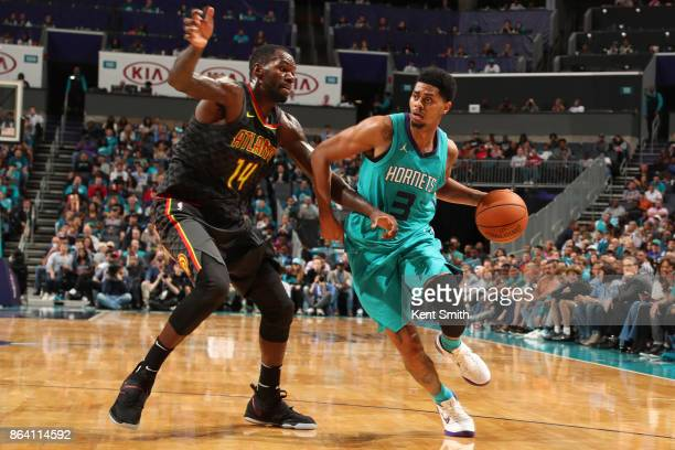 Jeremy Lamb of the Charlotte Hornets handles the ball against Dewayne Dedmon of the Atlanta Hawks during the game on October 20 2017 at Spectrum...