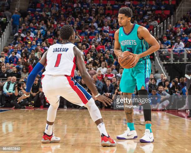 Jeremy Lamb of the Charlotte Hornets looks to make a play as Reggie Jackson of the Detroit Pistons defendsduring the Inaugural NBA game at the new...