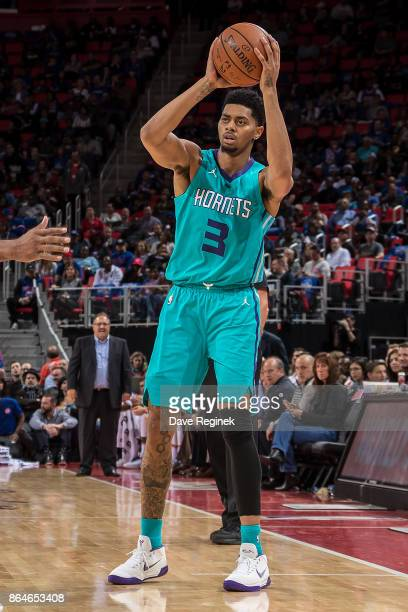 Jeremy Lamb of the Charlotte Hornets looks to pass the ball against the Detroit Pistons during the Inaugural NBA game at the new Little Caesars Arena...