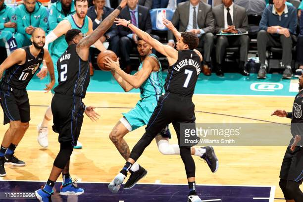 Jeremy Lamb of the Charlotte Hornets looks to pass the ball during the game against the Orlando Magic on April 10 2019 at Spectrum Center in...