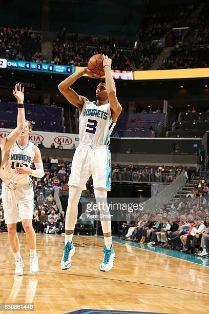 Jeremy Lamb of the Charlotte Hornets passes the ball against the Miami Heat during the game on December 29 2016 at Spectrum Center in Charlotte North...