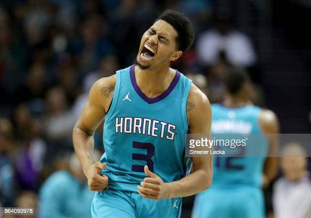 Jeremy Lamb of the Charlotte Hornets reacts after a play against the Atlanta Hawks during their game at Spectrum Center on October 20 2017 in...