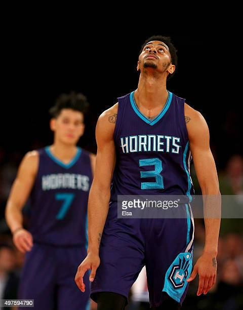 Jeremy Lamb of the Charlotte Hornets reacts after he missed a shot in the final minutes of the game against the New York Knicks as teammate Jeremy...