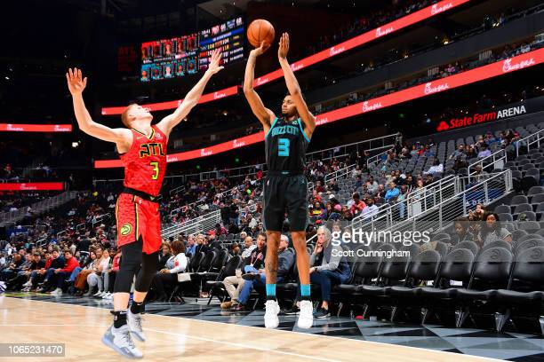 Jeremy Lamb of the Charlotte Hornets shoots the ball against the Atlanta Hawks on November 25 2018 at State Farm Arena in Atlanta Georgia NOTE TO...