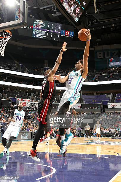 Jeremy Lamb of the Charlotte Hornets shoots the ball against the Miami Heat on October 20 2016 at the Spectrum Center in Charlotte North Carolina...