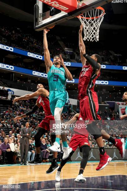 Jeremy Lamb of the Charlotte Hornets shoots the ball against the Miami Heat on December 15 2017 at Spectrum Center in Charlotte North Carolina NOTE...