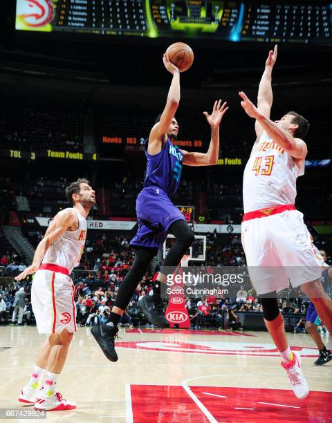 Jeremy Lamb of the Charlotte Hornets shoots the ball against the Atlanta Hawks during the game on April 11 2017 at Philips Arena in Atlanta Georgia...