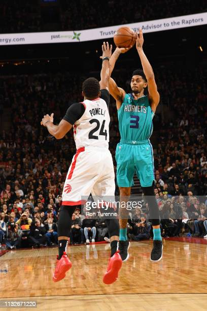 Jeremy Lamb of the Charlotte Hornets shoots the ball during the game against Norman Powell of the Toronto Raptors on March 24 2019 at the Scotiabank...
