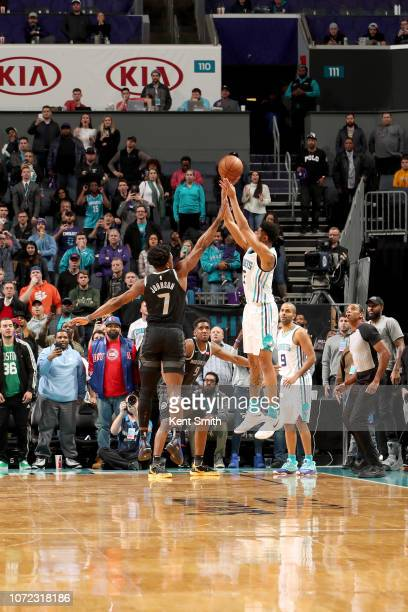 Jeremy Lamb of the Charlotte Hornets shoots the game winning shot against the Detroit Pistons on December 12 2018 at Spectrum Center in Charlotte...