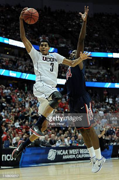Jeremy Lamb of the Connecticut Huskies dunks the ball against Solomon Hill of the Arizona Wildcats during the west regional final of the 2011 NCAA...