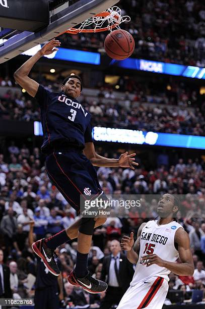 Jeremy Lamb of the Connecticut Huskies dunks the ball towards the end of the game against Kawhi Leonard of the San Diego State Aztecs during the west...