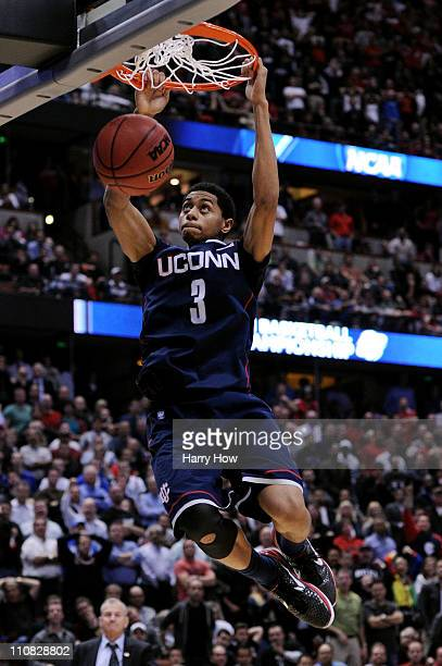 Jeremy Lamb of the Connecticut Huskies dunks the ball towards the end of the game against of the San Diego State Aztecs during the west regional...