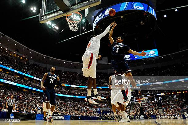 Jeremy Lamb of the Connecticut Huskies shoot over Brian Carlwell of the San Diego State Aztecs during the west regional semifinal of the 2011 NCAA...
