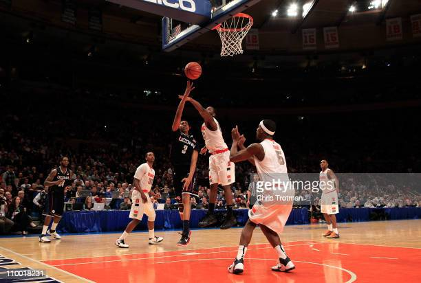 Jeremy Lamb of the Connecticut Huskies shoots the game winning basket against Rick Jackson of the Syracuse Orange during the semifinals of the 2011...