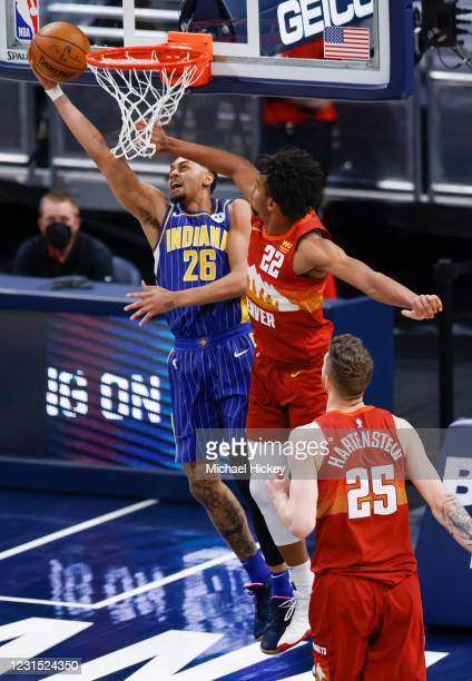 Jeremy Lamb of the Indiana Pacers shoots the ball against Zeke Nnaji of the Denver Nuggets during the second half at Bankers Life Fieldhouse on March...