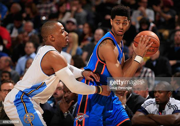 Jeremy Lamb of the Oklahoma City Thunder controls the ball against Randy Foye of the Denver Nuggets at Pepsi Center on November 19 2014 in Denver...