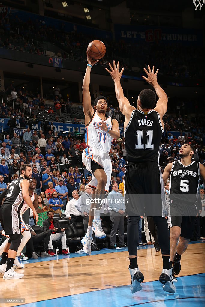 Jeremy Lamb #11 of the Oklahoma City Thunder shoots the ball against the San Antonio Spurs on April 7, 2015 at Chesapeake Energy Arena in Oklahoma City, Oklahoma.