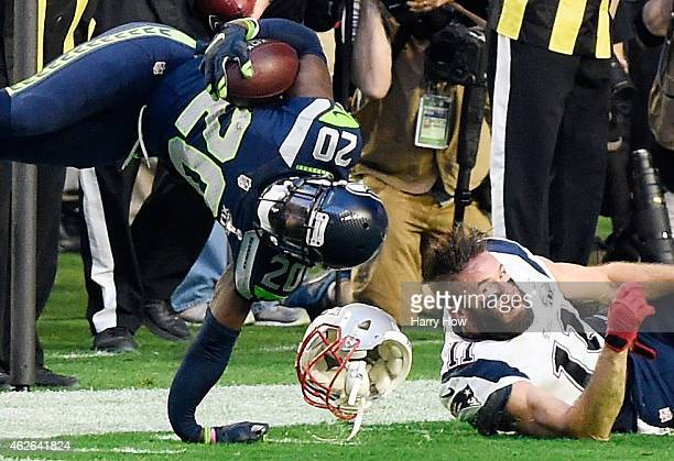 Jeremy Lane of the Seattle Seahawks breaks his arm after an interception as he is tackled by Julian Edelman of the New England Patriots in the first...