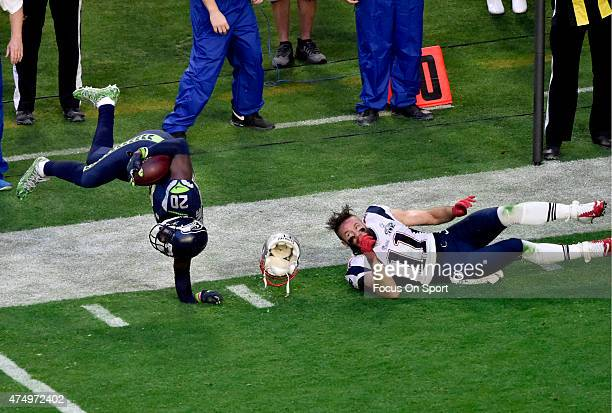 Jeremy Lane of the Seattle Seahawks gets tackled by Julian Edelman of the New England Patriots during Super Bowl XLIX February 1 2015 at the...