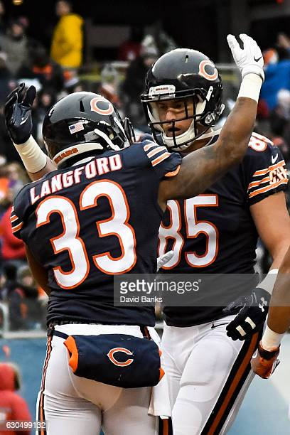 Jeremy Langford and Daniel Brown of the Chicago Bears celebrate after Langford scored in the second quarter against the Washington Redskins at...