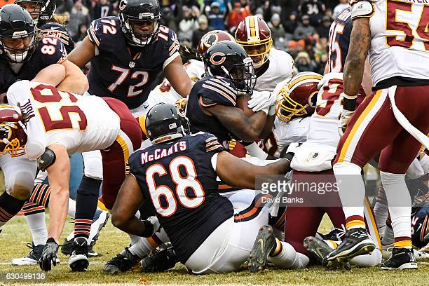 Jeremy Langford of the Chicago Bears carries the football into the endzone for a Bears touchdown against the Washington Redskins in the second...