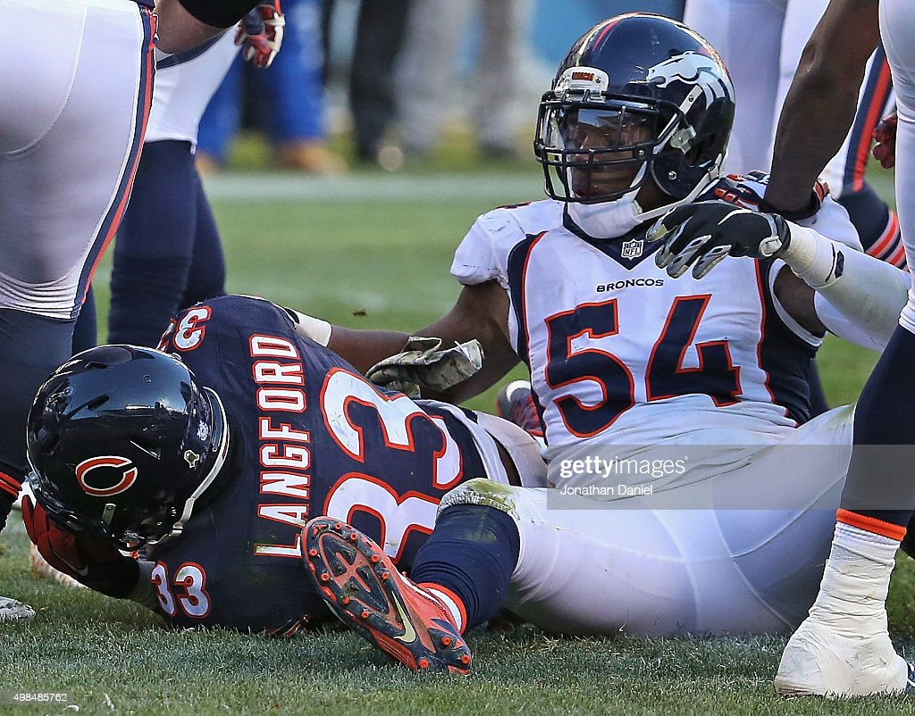 Jeremy Langford #33 of the Chicago Bears falls into the end zone to score a late touchdown past Brandon Marshall #54 of the Denver Broncos at Soldier Field on November 22, 2015 in Chicago, Illinois. The Broncos defeated the Bears 17-15.