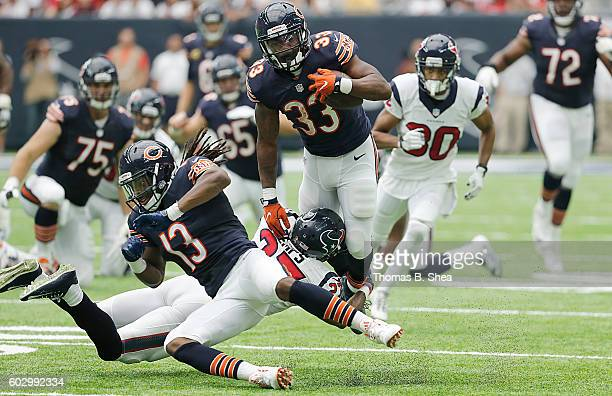 Jeremy Langford of the Chicago Bears is tackled by Quintin Demps of the Houston Texans in the second half at NRG Stadium on September 11 2016 in...