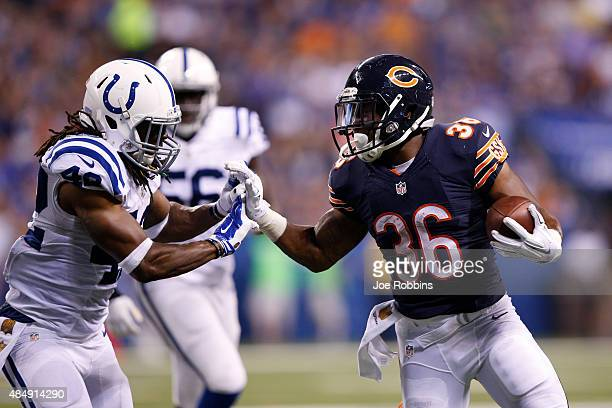 Jeremy Langford of the Chicago Bears runs the ball near the goal line against Clayton Geathers of the Indianapolis Colts in the second half of a...