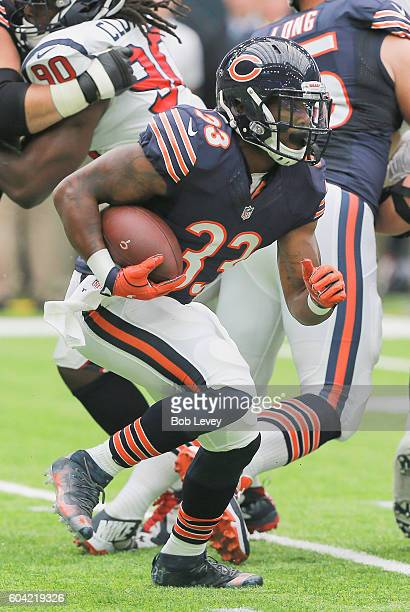 Jeremy Langford of the Chicago Bears rushes against the Houston Texans during a NFL football game at NRG Stadium on September 11, 2016 in Houston,...