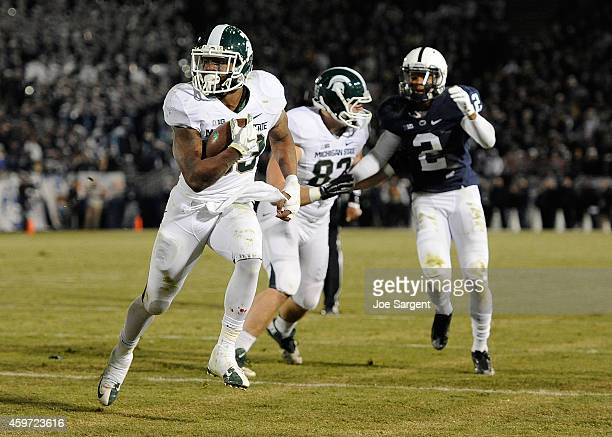 Jeremy Langford of the Michigan State Spartans carries the ball for a touchdown during the fourth quarter against the Penn State Nittany Lions at...