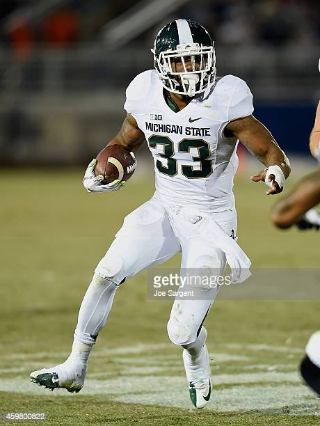 Jeremy Langford of the Michigan State Spartans carries the ball against the Penn State Nittany Lions at Beaver Stadium on November 29, 2014 in State...