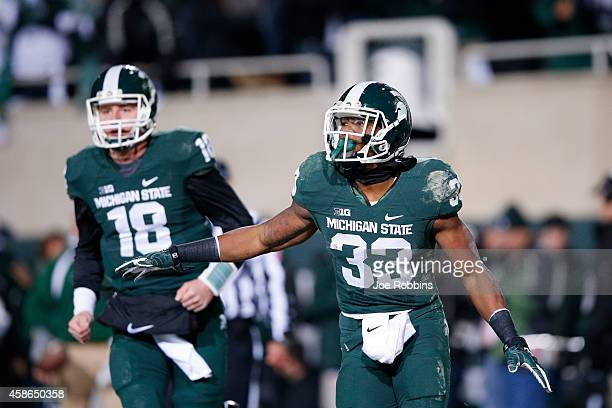 Jeremy Langford of the Michigan State Spartans celebrates after running for a 33-yard touchdown in the first quarter of the game against the Ohio...