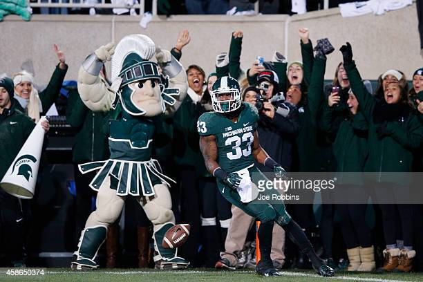 Jeremy Langford of the Michigan State Spartans celebrates after running for a 33yard touchdown in the first quarter of the game against the Ohio...