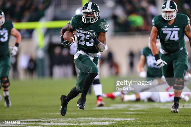Jeremy Langford of the Michigan State Spartans runs against the Ohio State Buckeyes at Spartan Stadium on November 8, 2014 in East Lansing, Michigan.