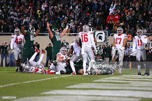 Jeremy Langford of the Michigan State Spartans runs for a touchdown against the Ohio State Buckeyes at Spartan Stadium on November 8, 2014 in East...