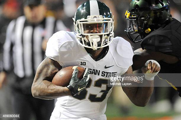 Jeremy Langford of the Michigan State Spartans runs for a touchdown in the fourth quarter during a college football game against the Maryland...