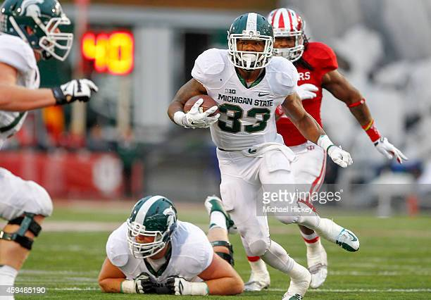 Jeremy Langford of the Michigan State Spartans runs the ball against the Indiana Hoosiers at Memorial Stadium on October 18, 2014 in Bloomington,...