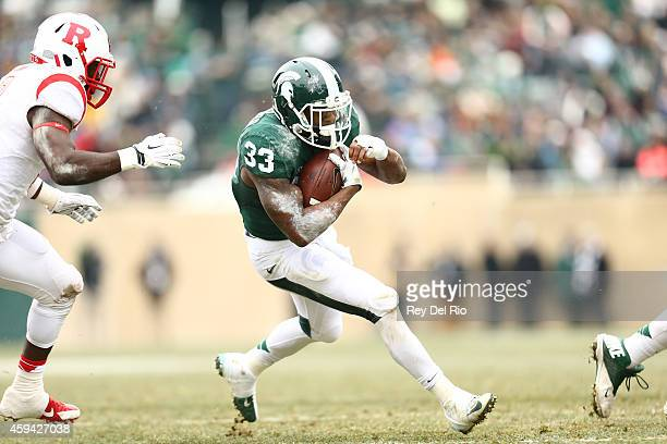 Jeremy Langford of the Michigan State Spartans runs the football against Rutgers Scarlet Knights during the first half of a game at Spartan Stadium...