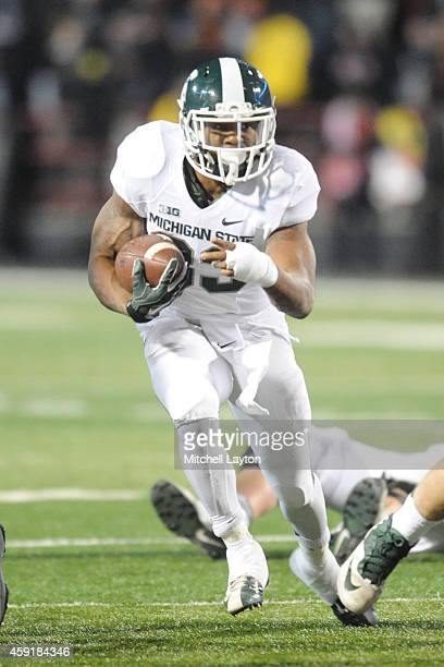 Jeremy Langford of the Michigan State Spartans runs wit the ball during a college football game against the Maryland Terrapins at Byrd Stadium on...