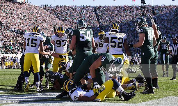 Jeremy Langford of the Michigan State Spartans scores on a two yard run during the first quarter of the game against the Michigan Wolverines at...