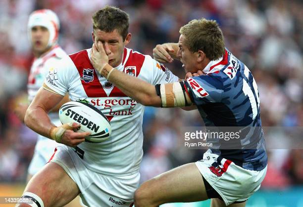 Jeremy Latimore of the Dragons is tackled by Mitch Aubusson of the Roosters during the round eight NRL match between the St George Illawarra Dragons...