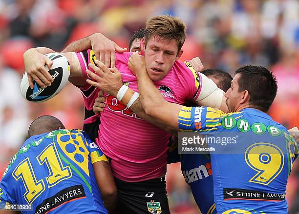 Jeremy Latimore of the Panthers is tackled by Manu Ma'u and Isaac De Gois of the Eels during the NRL Trial Match between the Penrith Panthers and the...