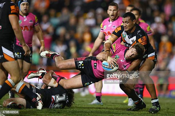 Jeremy Latimore of the Panthers is tackled during the round 16 NRL match between the Wests Tigers and the Penrith Panthers at Leichhardt Oval on June...